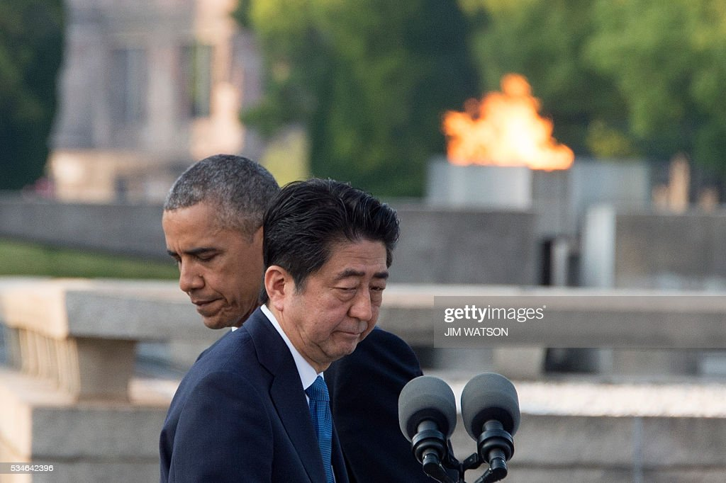 Japanese Prime Minister Shinzo Abe (front R) prepares to speak following US President Barack Obama (L) made remarks after the two placed wreaths during a visit to the Hiroshima Peace Memorial Park in Hiroshima on May 27, 2016. Obama on May 27 paid moving tribute to victims of the world's first nuclear attack. WATSON