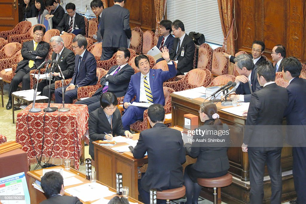 Japanese Prime Minister <a gi-track='captionPersonalityLinkClicked' href=/galleries/search?phrase=Shinzo+Abe&family=editorial&specificpeople=559017 ng-click='$event.stopPropagation()'>Shinzo Abe</a> raises hand during a lower house budget committee session at the diet building on February 10, 2016 in Tokyo, Japan.