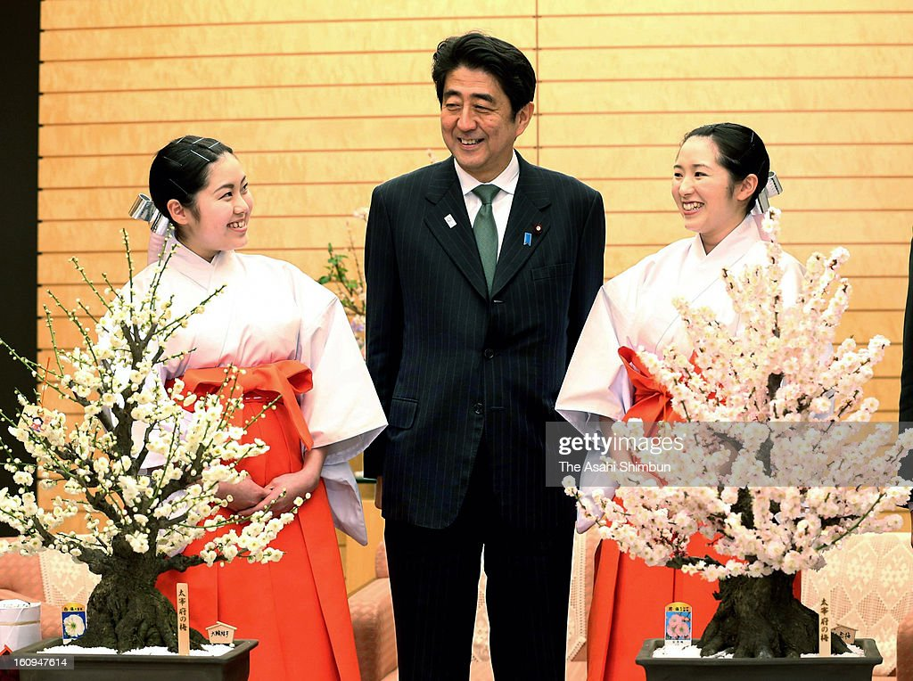 Japanese Prime Minister Shinzo Abe receives the annual courtesy call by 'plum envoys' from Dazaifu Tenmangu Shrine at his official residence on February 6, 2013 in Tokyo, Japan.