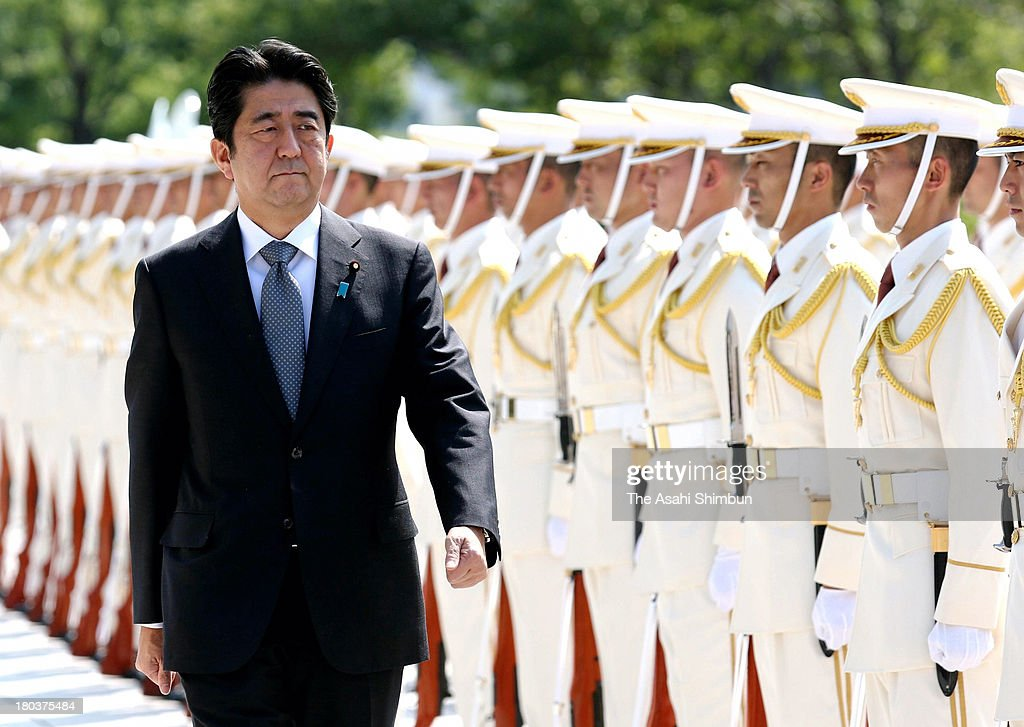 Japanese Prime Minister <a gi-track='captionPersonalityLinkClicked' href=/galleries/search?phrase=Shinzo+Abe&family=editorial&specificpeople=559017 ng-click='$event.stopPropagation()'>Shinzo Abe</a> reviews honor guard at the Defense Ministry on September 12, 2013 in Tokyo, Japan.