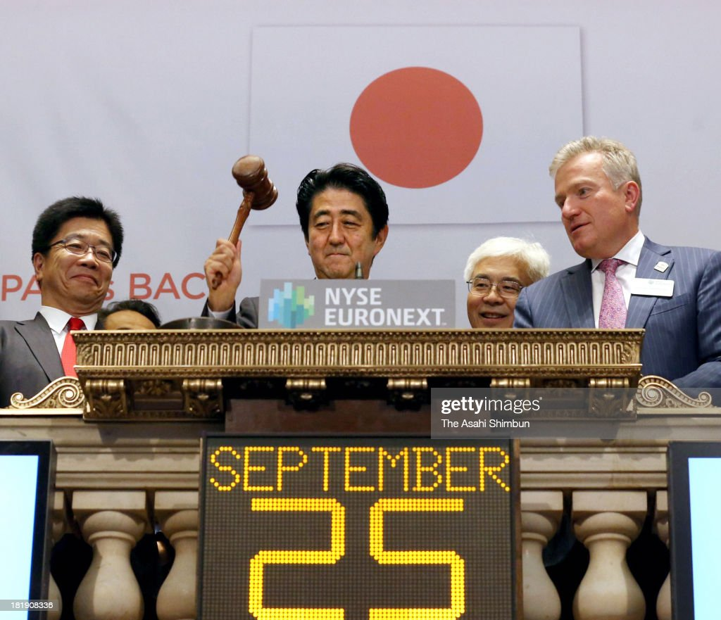Japanese Prime Minister <a gi-track='captionPersonalityLinkClicked' href=/galleries/search?phrase=Shinzo+Abe&family=editorial&specificpeople=559017 ng-click='$event.stopPropagation()'>Shinzo Abe</a> rings the closing bell during his visit to the New York Stock Exchange on September 25, 2013 in New York. Abe spoke on 'Abenomics' and Japan's economic recovery.