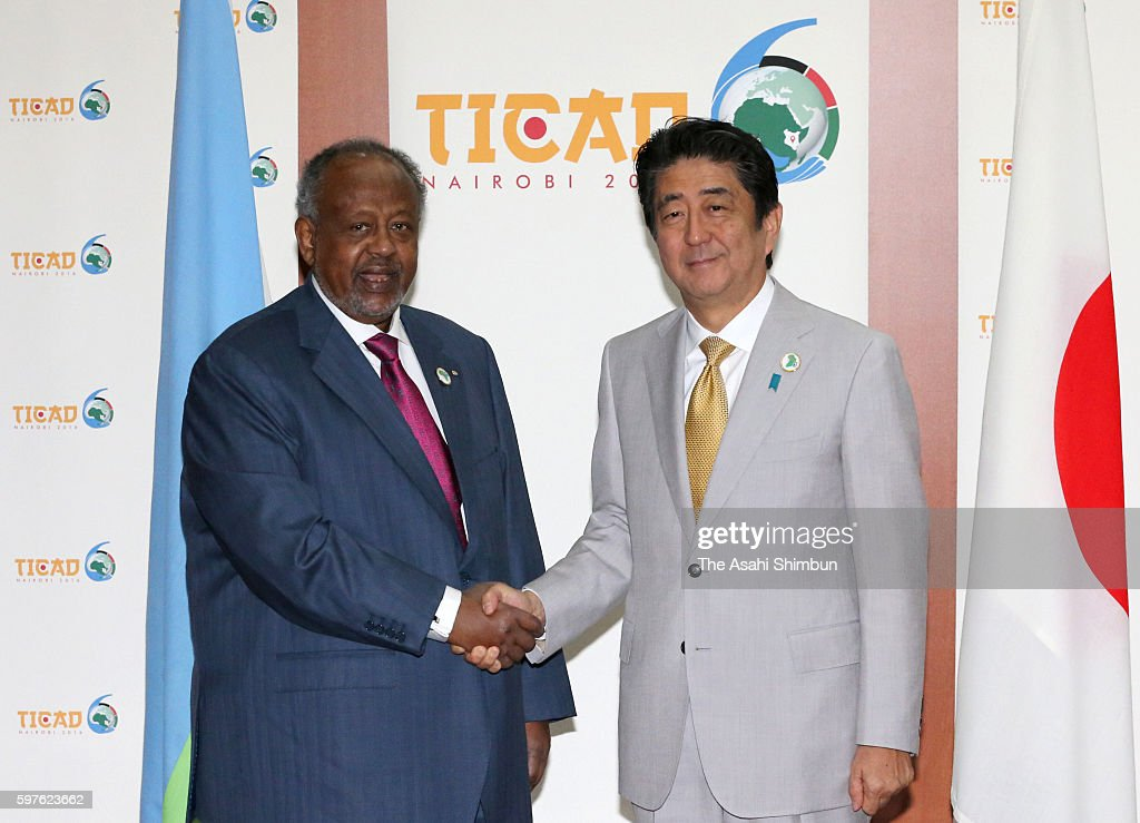 Japanese Prime Minister Shinzo Abe shakes hands with Djibouti President Ismaaciil Cumar Geelle prior to their meeting on the sidelines of the Tokyo...