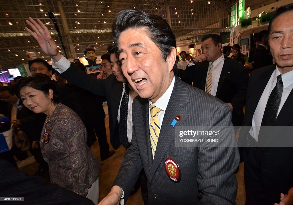 Japanese Prime Minister Shinzo Abe shakes hands with his supporters after he delivered a speech at an offline meeting sponsored by Japan's video sharing website 'Niconico Douga' (smiling video) in Chiba, suburban Tokyo on April 26, 2014. US President Barack Obama was all about business even at a special sushi dinner in Tokyo, which Abe wanted to use as a bonding opportunity. 'It was all about work,' Abe told his key ministers on April 25 night about his conversation with the US leader during their private dinner on April 23 at an exclusive Michelin-starred restaurant. AFP PHOTO / Yoshikazu TSUNO