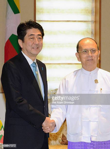 Japanese Prime Minister Shinzo Abe shakes hands with Myanmar President Thein Sein ahead of their summit meeting on the sidelines of the 25th ASEAN...