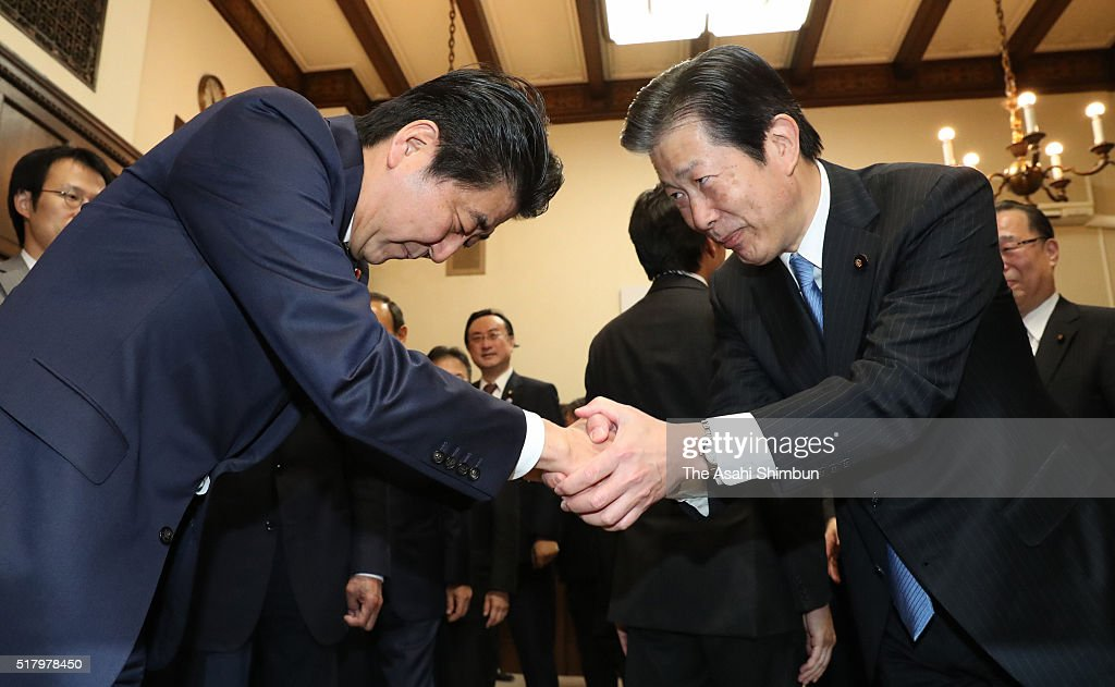 Japanese Prime Minister <a gi-track='captionPersonalityLinkClicked' href=/galleries/search?phrase=Shinzo+Abe&family=editorial&specificpeople=559017 ng-click='$event.stopPropagation()'>Shinzo Abe</a> (L) shakes hands with the junior coalition Komeito leader <a gi-track='captionPersonalityLinkClicked' href=/galleries/search?phrase=Natsuo+Yamaguchi&family=editorial&specificpeople=5718603 ng-click='$event.stopPropagation()'>Natsuo Yamaguchi</a> after the budget for fiscal 2016 was enacted at the diet building on March 29, 2016 in Tokyo, Japan. The upper house approved a record 96.72 trillion Japanese yen budget for fiscal 2016.