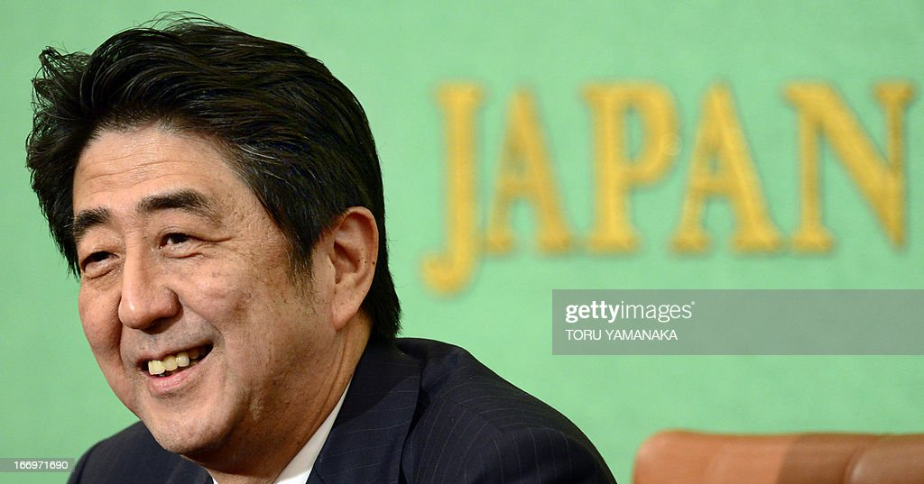 Japanese Prime Minister Shinzo Abe smiles as he listens to questions during a press conference at the Japan National Press Club in Tokyo on April 19, 2013. Abe unveiled growth strategies aimed at perking up the economy in the latest tranche of a policy blitz that has rallied stocks and boosted his popularity. AFP PHOTO/Toru YAMANAKA
