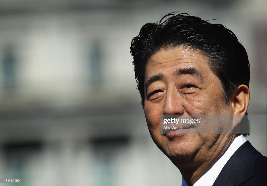 Japanese Prime Minister <a gi-track='captionPersonalityLinkClicked' href=/galleries/search?phrase=Shinzo+Abe&family=editorial&specificpeople=559017 ng-click='$event.stopPropagation()'>Shinzo Abe</a> smiles as U.S. President Barack Obama welcomes him during an official arrival ceremony at the South Lawn of the White House April 28, 2015 in Washington, DC. The Japanese Prime Minister and his wife are on an official visit to Washington.