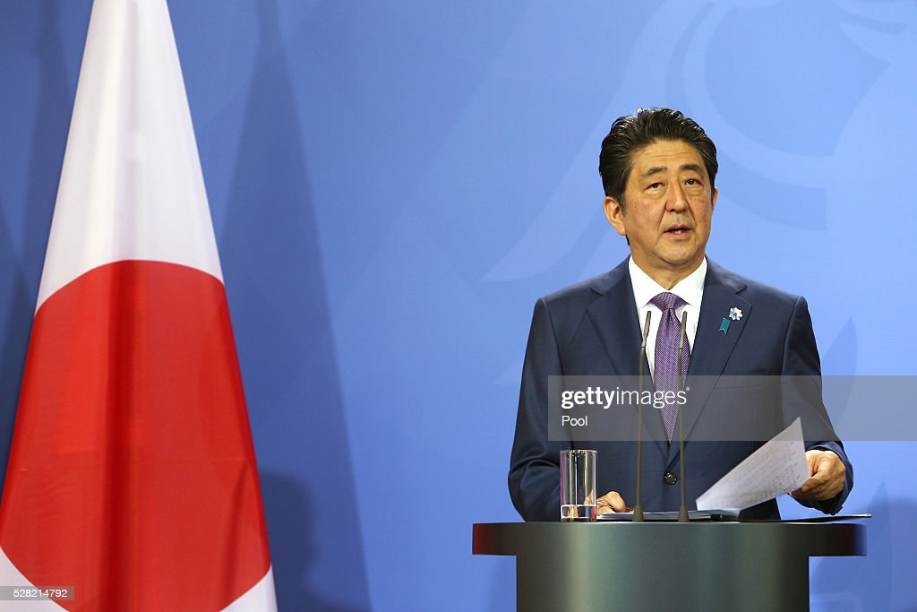 Japanese Prime Minister <a gi-track='captionPersonalityLinkClicked' href=/galleries/search?phrase=Shinzo+Abe&family=editorial&specificpeople=559017 ng-click='$event.stopPropagation()'>Shinzo Abe</a> speak to the media during a joint press conference with German Chancellor Angela Merkel (not pictured) following talks at Schloss Meseberg palace on May 4, 2016 in Meseberg, Germany. The two leaders are meeting ahead of the upcoming G7 summit in Japan and also discussed both bilateral and international issues.
