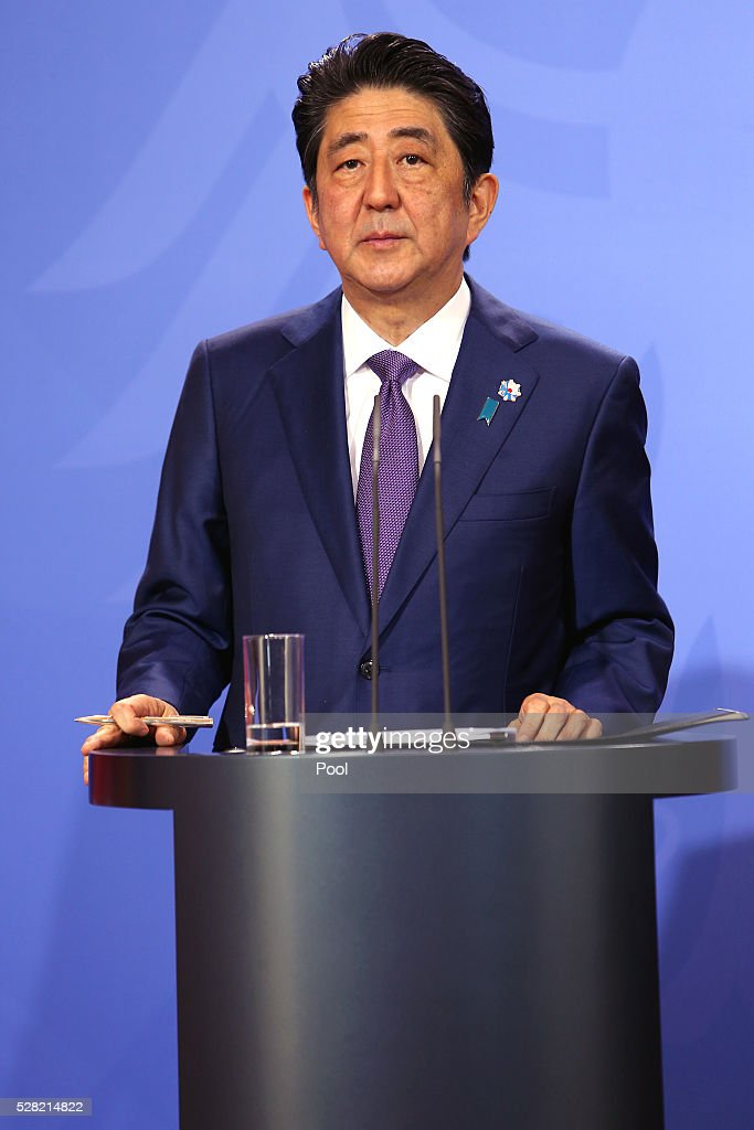 Japanese Prime Minister <a gi-track='captionPersonalityLinkClicked' href=/galleries/search?phrase=Shinzo+Abe&family=editorial&specificpeople=559017 ng-click='$event.stopPropagation()'>Shinzo Abe</a> speak to the media during a joint press conference with German Chancellor <a gi-track='captionPersonalityLinkClicked' href=/galleries/search?phrase=Angela+Merkel&family=editorial&specificpeople=202161 ng-click='$event.stopPropagation()'>Angela Merkel</a> (not pictured) following talks at Schloss Meseberg palace on May 4, 2016 in Meseberg, Germany. The two leaders are meeting ahead of the upcoming G7 summit in Japan and also discussed both bilateral and international issues.