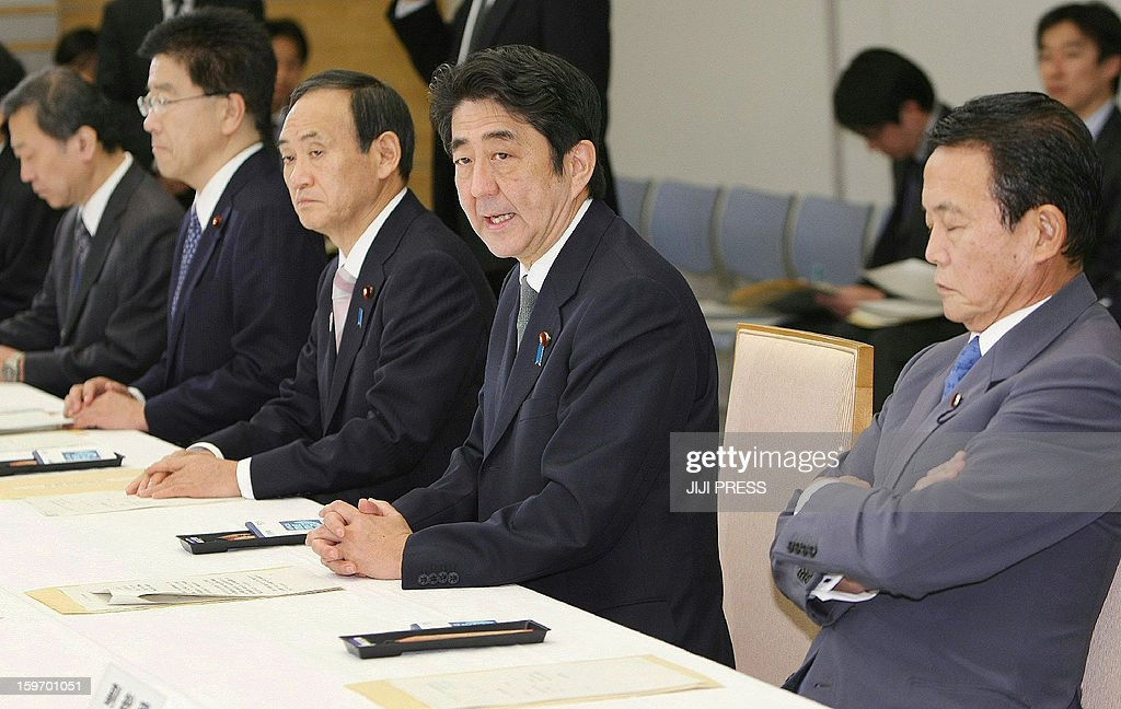 Japanese Prime Minister Shinzo Abe (2nd R) speaks at a cabinet-level meeting to co-ordinate its response to hostage issues in Algeria at the prime minister's official residence in Tokyo on January 19, 2013. Abe came back home on January 19 from his tour to Southeast Asian countries earlier than his original schedule to take charge of Japan's response to the desert hostage crisis in which at least 10 of its nationals are still missing. AFP PHOTO/Jiji Press JAPAN OUT