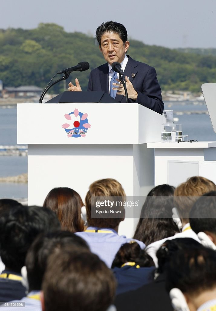 Japanese Prime Minister <a gi-track='captionPersonalityLinkClicked' href=/galleries/search?phrase=Shinzo+Abe&family=editorial&specificpeople=559017 ng-click='$event.stopPropagation()'>Shinzo Abe</a> speaks at a press conference in the central Japan city of Shima on May 27, 2016, following a two-day Group of Seven summit. Abe said the G-7 leaders agreed to implement monetary, fiscal and structural policies as they shared a 'strong sense of crisis' over the current global economy.