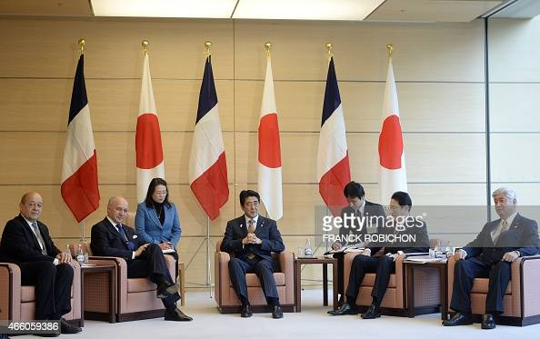 Japanese Prime Minister Shinzo Abe speaks at the start his meeting with French Defense Minister JeanYves Le Drian and Foreign Minister Laurent Fabius...