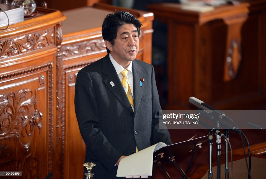 Japanese Prime Minister Shinzo Abe speaks at the Upper House's plenary session at the National Diet in Tokyo on February 1, 2013. Japan's hawkish Prime Minister Shinzo Abe told lawmakers he would release a new statement on the World War II, a move likely to set nerves on edge in China and beyond. AFP PHOTO / Yoshikazu TSUNO