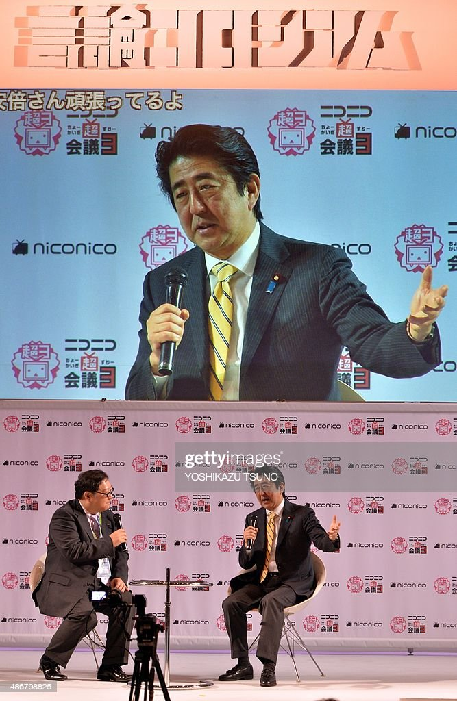 Japanese Prime Minister Shinzo Abe speaks before his supporters at an offline meeting sponsored by Japan's video sharing website 'Niconico Douga' (smiling video) in Chiba, suburban Tokyo on April 26, 2014. US President Barack Obama was all about business even at a special sushi dinner in Tokyo, which Abe wanted to use as a bonding opportunity. 'It was all about work,' Abe told his key ministers on April 25 night about his conversation with the US leader during their private dinner on April 23 at an exclusive Michelin-starred restaurant. AFP PHOTO / Yoshikazu TSUNO