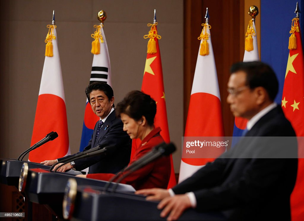 Japanese Prime Minister Shinzo Abe speaks besides Chinese Premier Li Keqiang and South Korean President Park Geunhye during a news conference at the...