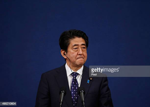 Japanese Prime Minister Shinzo Abe speaks during a joint news conference after trilateral summit at the presidential Blue House on November 1 2015 in...