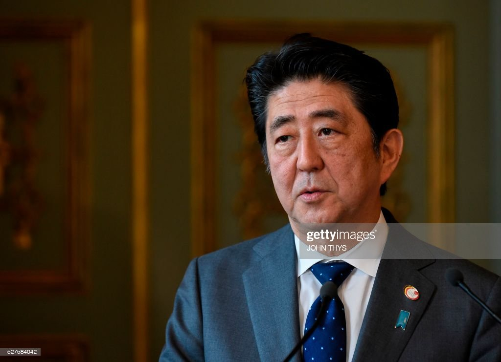 Japanese Prime Minister Shinzo Abe speaks during a joint press conference with Belgian Prime minister after their meeting in Brussels on May 3, 2016. / AFP / JOHN