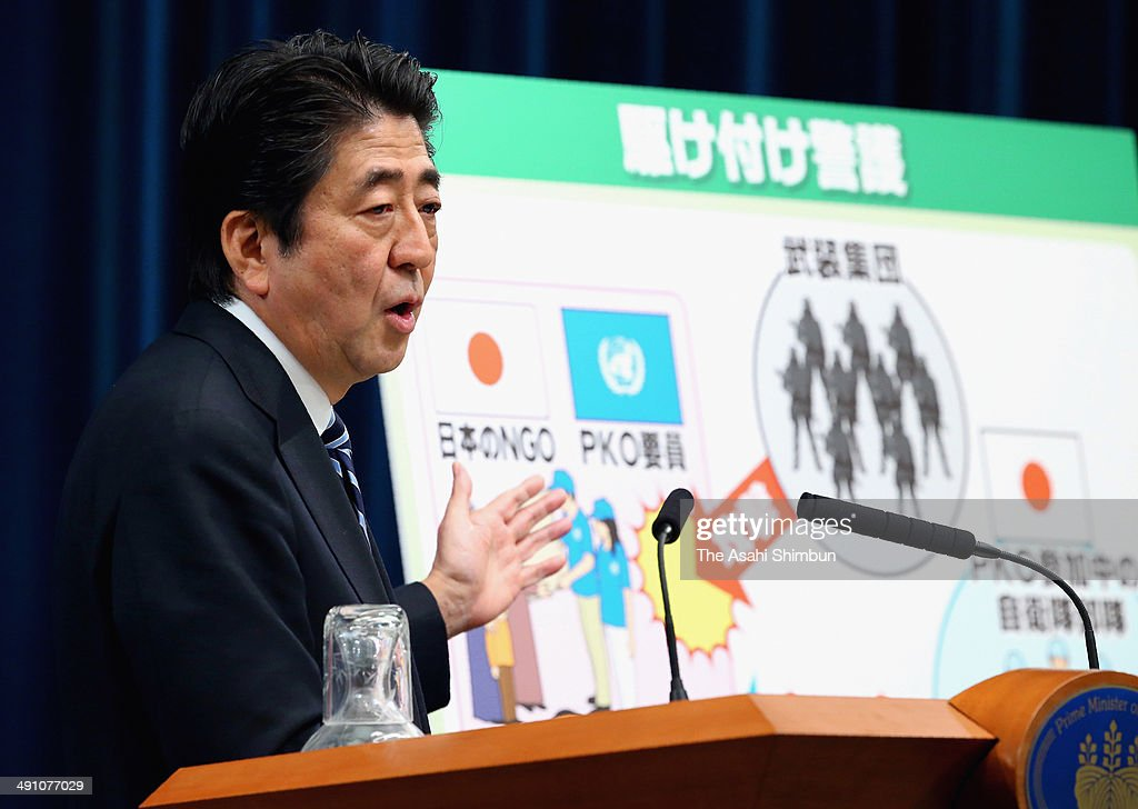 Japanese Prime Minister Shinzo Abe speaks during a news conference on May 15, 2014 in Tokyo, Japan. Abe made clear his government will lift Japanfs self-imposed ban on exercising the right to collective self-defense, saying the change will help to prevent Japan from going to war.