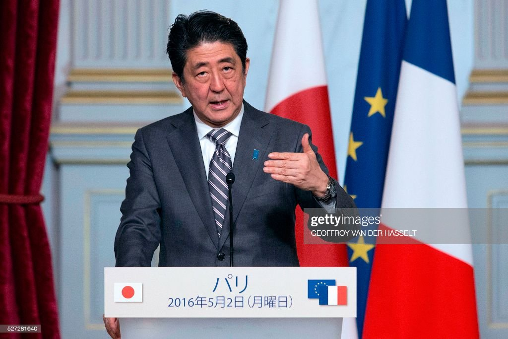 Japanese Prime Minister Shinzo Abe speaks during a press conference with the French president (not seen) in Paris on May 2, 2016. / AFP / GEOFFROY