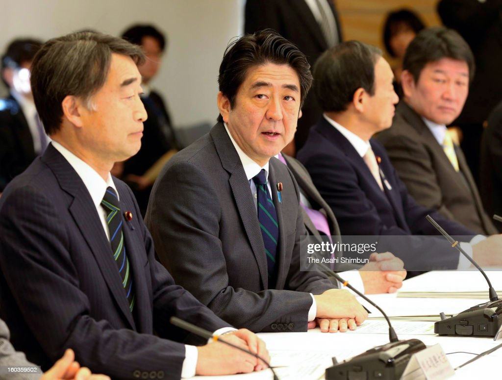 Japanese Prime Minister Shinzo Abe speaks during a reconstruction promotion committee at his official residene on January 29, 0213 in Tokyo, Japan. The government decides to set up the Reconstruction Agency Fukushima Headquaters to enhance the restoration from the earthquake, tsunami and nuclear plant accident.