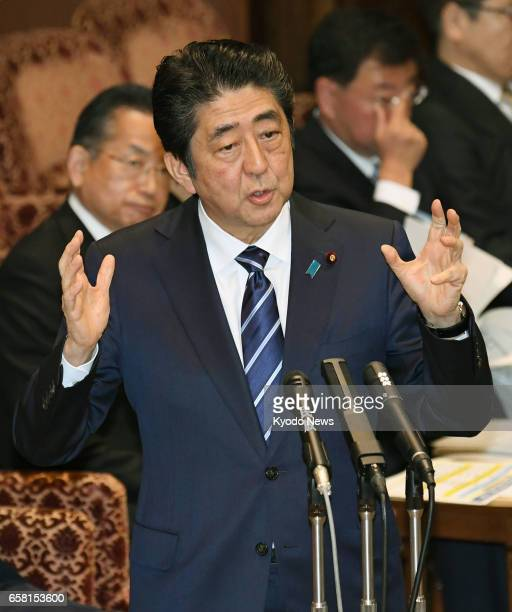 Japanese Prime Minister Shinzo Abe speaks during a session of a House of Councillors committee in Tokyo on March 27 2017 ==Kyodo