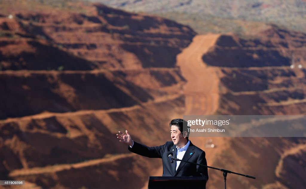 Japanese Prime Minister <a gi-track='captionPersonalityLinkClicked' href=/galleries/search?phrase=Shinzo+Abe&family=editorial&specificpeople=559017 ng-click='$event.stopPropagation()'>Shinzo Abe</a> speaks during a tour of the Rio Tinto West Angelas iron ore mine in the Pilbara on July 9, 2014 in the Pilbara, West Australia. The Japanese Prime Minister is in Australia for three days and will sign a Economic Partnership Agreement with Australia. Japan is Australia's second biggest trading partner.