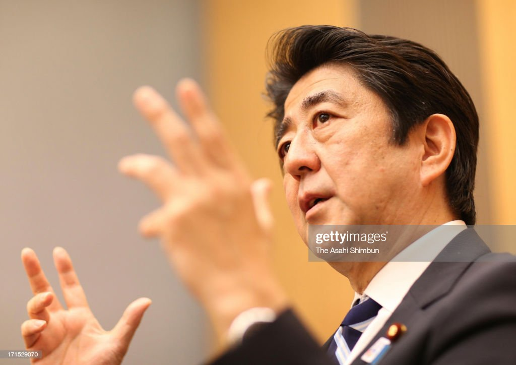 Japanese Prime Minister <a gi-track='captionPersonalityLinkClicked' href=/galleries/search?phrase=Shinzo+Abe&family=editorial&specificpeople=559017 ng-click='$event.stopPropagation()'>Shinzo Abe</a> speaks during the Asahi Shimbun Interview at his official residence on June 25, 2013 in Tokyo, Japan.