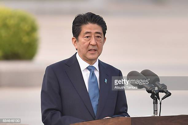 Japanese Prime Minister Shinzo Abe speaks during US President Obama's visit to the Hiroshima Peace Memorial Park on May 27 2016 in Hiroshima Japan It...