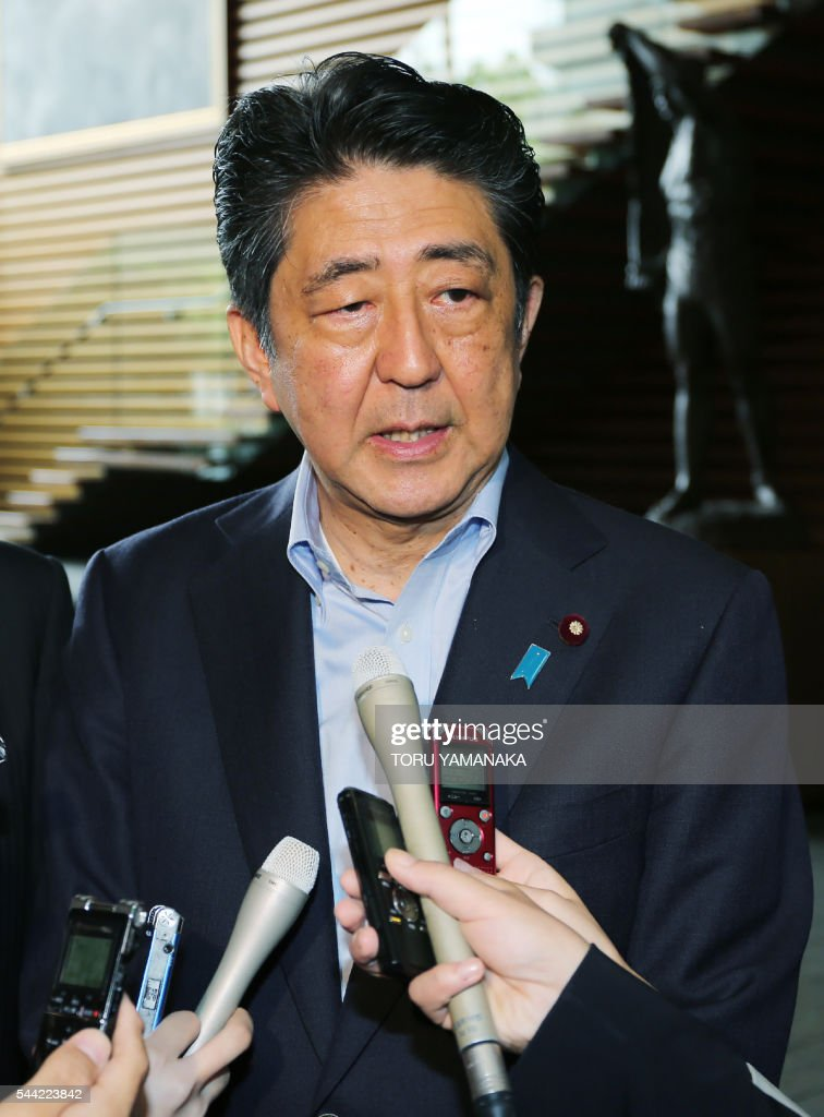 Japanese Prime Minister Shinzo Abe speaks to journalists after a cabinet meeting to talk about Dhaka hostage case which suspected Islamist militants hold dozens of people hostage, at his official residence in Tokyo on July 2, 2016. / AFP / JIJI PRESS / TORU YAMANAKA / Japan OUT