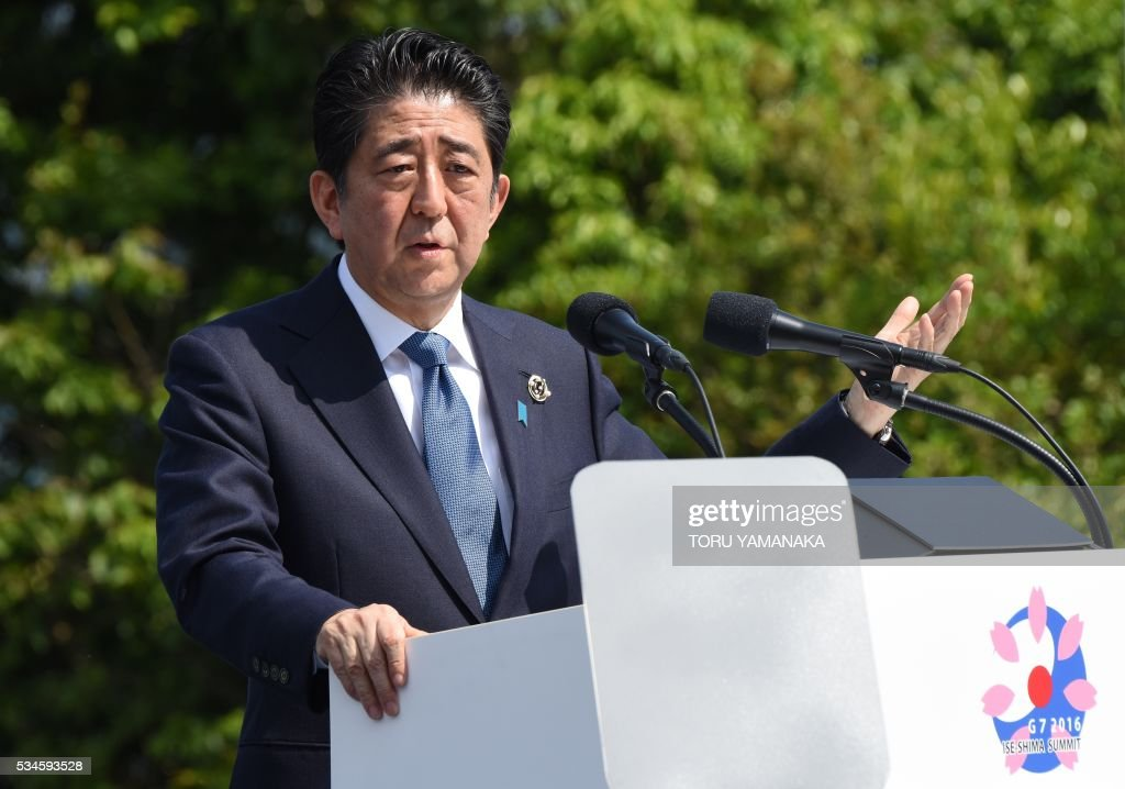 Japanese Prime Minister Shinzo Abe speaks to journalists at a press conference at the end of the two-day Group of Seven (G7) Summit meeting at Shima on May 27, 2016. Pumping up the world economy is an 'urgent priority' G7 leaders said on May 27, but left the door open for a go-your-own-way approach in a sign of lingering divisions over how to boost growth. / AFP / TORU