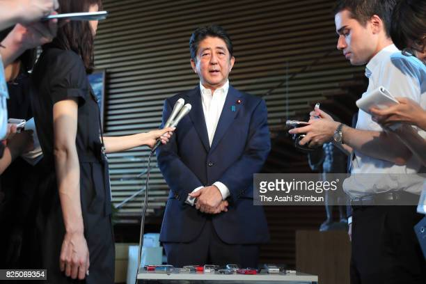 Japanese Prime Minister Shinzo Abe speaks to media reporters after hosting the National Security Council at his official residence on July 29 2017 in...