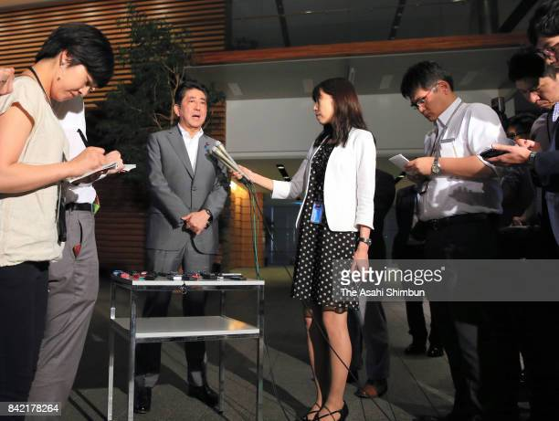 Japanese Prime Minister Shinzo Abe speaks to media reporters after North Korea's nuclear test at his official residence on September 3 2017 in Tokyo...