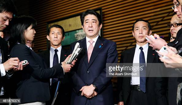 Japanese Prime Minister Shinzo Abe speaks to media reporters at his official residence on January 21 2015 in Tokyo Japan Japan has been threatened by...