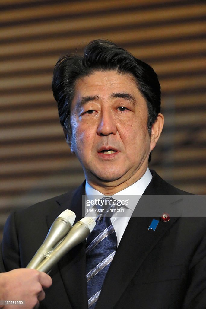 Japanese Prime Minister <a gi-track='captionPersonalityLinkClicked' href=/galleries/search?phrase=Shinzo+Abe&family=editorial&specificpeople=559017 ng-click='$event.stopPropagation()'>Shinzo Abe</a> speaks to media reporters at his official residence on February 1, 2015 in Tokyo, Japan. The video purported to show the Islamic State militant group apparently beheaded freelance journalist Kenji Goto.