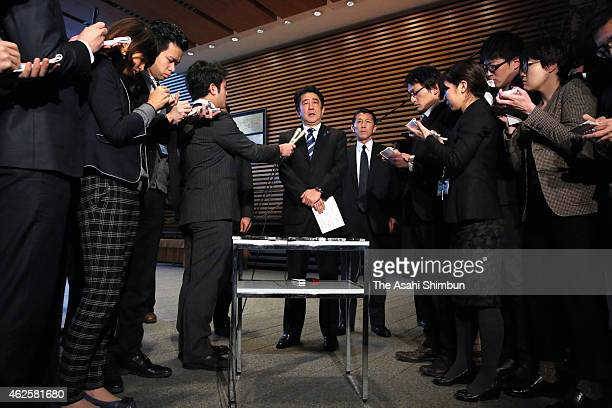 Japanese Prime Minister Shinzo Abe speaks to media reporters at his official residence on February 1 2015 in Tokyo Japan The video purported to show...