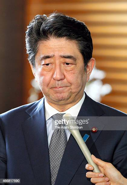 Japanese Prime Minister Shinzo Abe speaks to media reporters at his official residence on March 19 2015 in Tokyo Japan Japanese government confirmed...