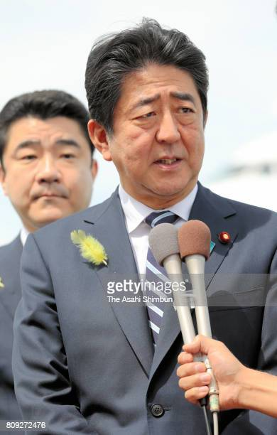 Japanese Prime Minister Shinzo Abe speaks to media reporters on departure for Europe at Haneda International Airport on July 5 2017 in Tokyo Japan...