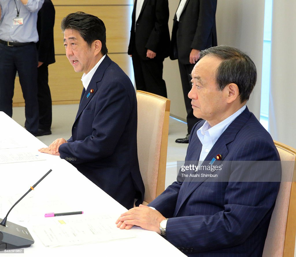 Japanese Prime Minister <a gi-track='captionPersonalityLinkClicked' href=/galleries/search?phrase=Shinzo+Abe&family=editorial&specificpeople=559017 ng-click='$event.stopPropagation()'>Shinzo Abe</a> (L) speaks while Chief Cabinet Secretary <a gi-track='captionPersonalityLinkClicked' href=/galleries/search?phrase=Yoshihide+Suga&family=editorial&specificpeople=3868279 ng-click='$event.stopPropagation()'>Yoshihide Suga</a> (R) listens during their meeting with the Bank of Japan Deputy Governor Hiroshi Nakaso and Finance Minister Taro Aso at Abe's official residence on June 27, 2016 in Tokyo, Japan. The government and the central bank held a meeting to measure the impact of the 'Brexit'.