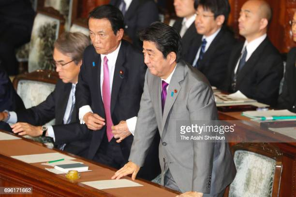 Japanese Prime Minister Shinzo Abe stands to bow after the Lower House voted down a noconfidence motion against his cabinet on June 15 2017 in Tokyo...
