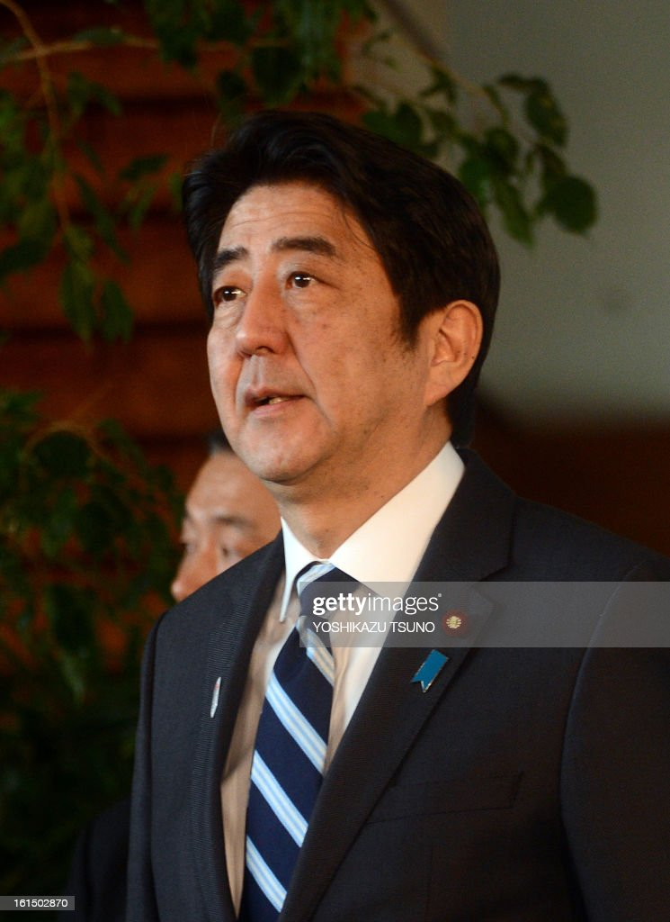Japanese Prime Minister Shinzo Abe talks to the press after he attended the security council meeting at his official residence in Tokyo on February 12, 2013. North Korea staged an apparent nuclear test of six to seven kilotons in a striking act of defiance that, if confirmed, is sure to trigger global condemnation from enemies and allies alike. AFP PHOTO / Yoshikazu TSUNO
