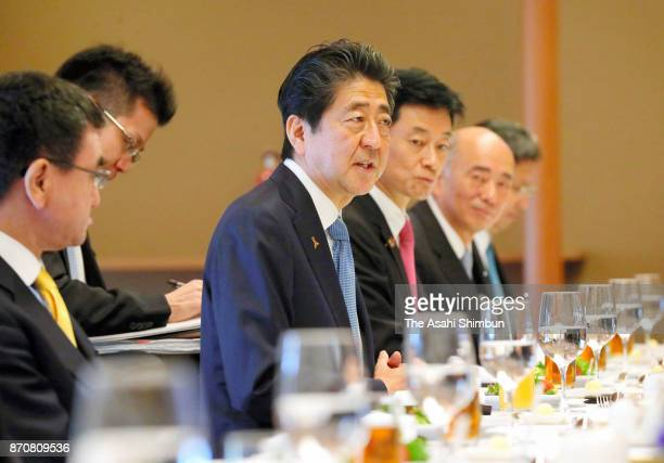 Japanese Prime Minister Shinzo Abe talks to US President Donald Trump during a working lunch at the Akasaka State Guest House on November 6 2017 in...
