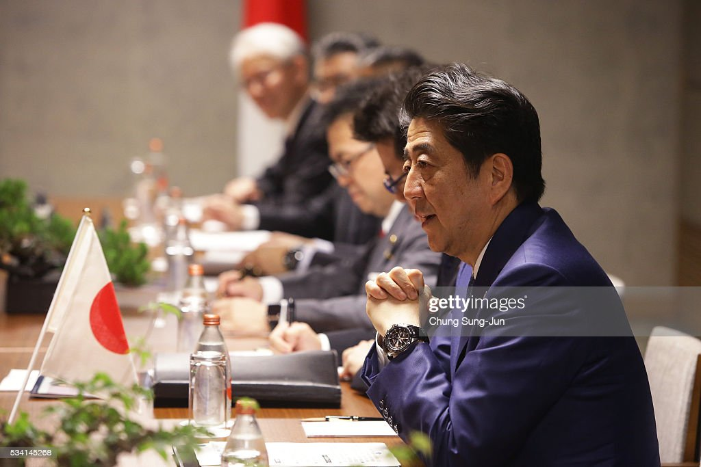 Japanese Prime Minister <a gi-track='captionPersonalityLinkClicked' href=/galleries/search?phrase=Shinzo+Abe&family=editorial&specificpeople=559017 ng-click='$event.stopPropagation()'>Shinzo Abe</a> talks with British Prime Minister David Cameron (not seen) during a bilateral meeting on May 24, 2016 in Shima, Japan. The G7 summit will be held on Japan's Kashikojima Island on May 26 and 27, 2016.