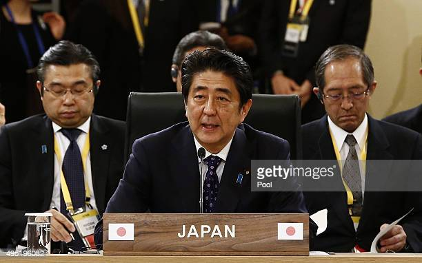 Japanese Prime Minister Shinzo Abe talks with Chinese Prime Minister Li Keqiang and South Korean President Park GeunHye during their trilateral...