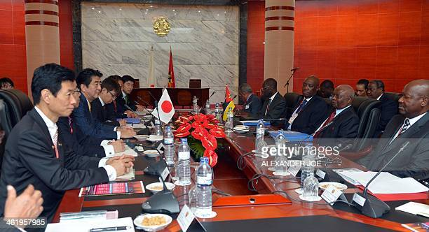 Japanese Prime Minister Shinzo Abe talks with Mozambique's President Armando Guebuza at the president's office in Maputo on January 12 2014 Abe on...