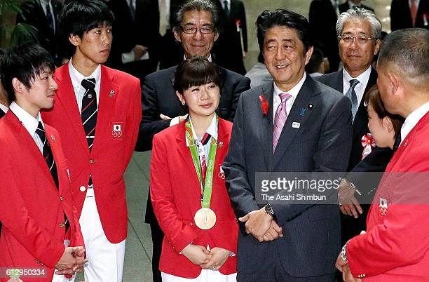 Japanese Prime Minister Shinzo Abe talks with the Japanese Rio 2016 athletes including Koki Niwa and Ai Fukuhara at the Rio 2016 Afterparty at the...