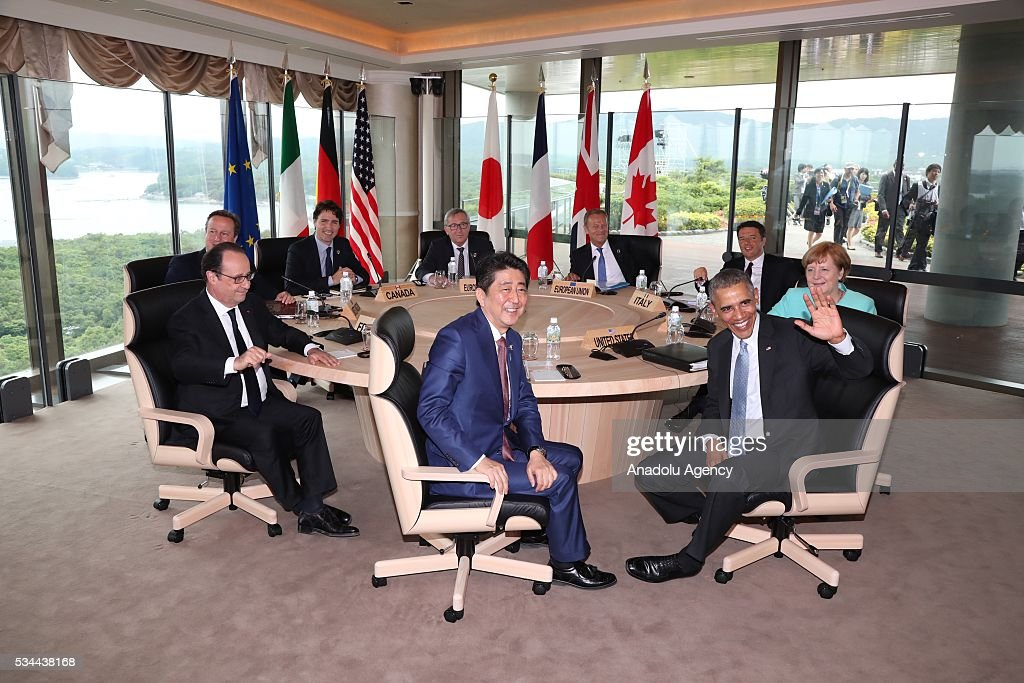 Japanese Prime Minister Shinzo Abe (front center), U.S. President Barack Obama (front right 2), German Chancellor Angela Merkel (right), Italian Prime Minister Matteo Renzi (rear right ), European Council President Donald Tusk (rear right 2), European Commission President Jean-Claude Juncker (rear center), Canadian Prime Minister Justin Trudeau (rear left 2), British Prime Minister David Cameron (rear left) and French President Francois Hollande (front left) are seen during the working lunch at the Shima Kanko Hotel in in Ise, Japan on May 26, 2016 on the first day of the G7 leaders summit in the city of Ise in Mie prefecture.