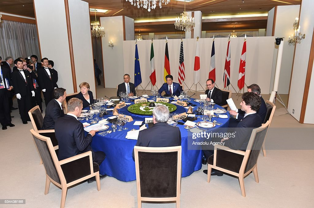 Japanese Prime Minister Shinzo Abe, U.S. President Barack Obama, German Chancellor Angela Merkel, Italian Prime Minister Matteo Renzi, European Council President Donald Tusk, European Commission President Jean-Claude Juncker, Canadian Prime Minister Justin Trudeau, British Prime Minister David Cameron and French President Francois Hollande are seen during the working dinner at the Shima Kanko Hotel in in Ise, Japan on May 26, 2016 on the first day of the G7 leaders summit in the city of Ise in Mie prefecture.