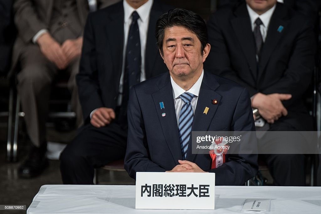 Japanese Prime Minister Shinzo Abe waits during a government-backed annual convention calling for the return of the islands in Tokyo on February 7, 2015. Soviet troops took the islands in the final days of World War II, turfing out several hundred Japanese who lived there at the time. The issue has prevented the signing of a formal peace treaty between the two countries.