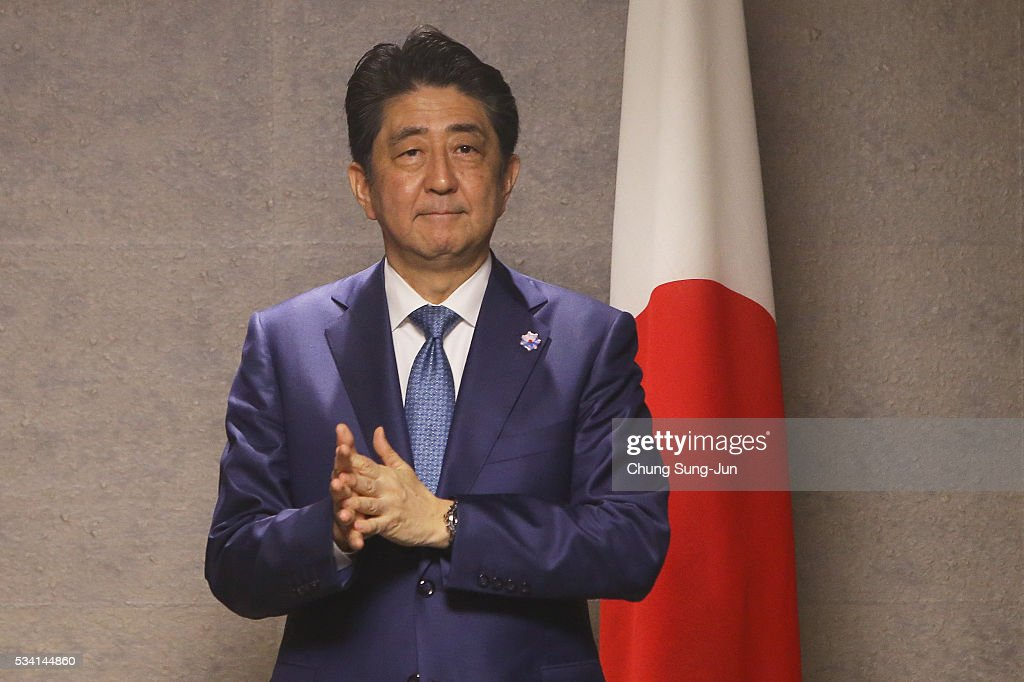 Japanese Prime Minister <a gi-track='captionPersonalityLinkClicked' href=/galleries/search?phrase=Shinzo+Abe&family=editorial&specificpeople=559017 ng-click='$event.stopPropagation()'>Shinzo Abe</a> waits for British Prime Minister David Cameron (not seen) before a bilateral meeting on May 24, 2016 in Shima, Japan. The G7 summit will be held on Japan's Kashikojima Island on May 26 and 27, 2016.