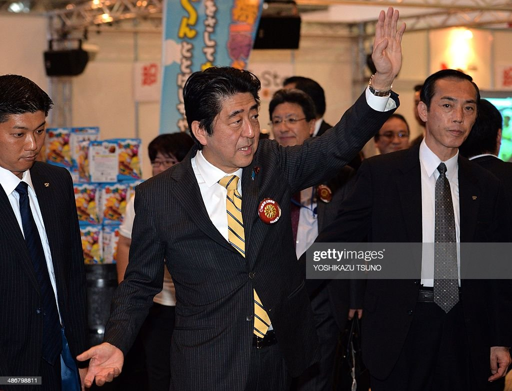 Japanese Prime Minister Shinzo Abe waves his hand to his supporters after he delivered a speech at an offline meeting sponsored by Japan's video sharing website 'Niconico Douga' (smiling video) in Chiba, suburban Tokyo on April 26, 2014. US President Barack Obama was all about business even at a special sushi dinner in Tokyo, which Abe wanted to use as a bonding opportunity. 'It was all about work,' Abe told his key ministers on April 25 night about his conversation with the US leader during their private dinner on April 23 at an exclusive Michelin-starred restaurant. AFP PHOTO / Yoshikazu TSUNO